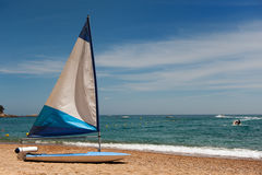 Sailing at the beach Stock Image