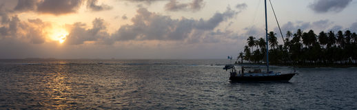 Sailing with beautiful sunset near paradise island, San Blas Royalty Free Stock Images