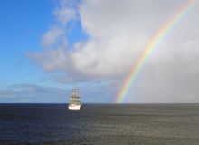 Sailing below the rainbow Royalty Free Stock Image