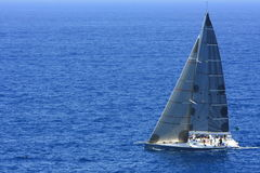 Sailing on the big blue ocean Stock Images