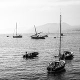 Sailing black and white. Summer leisure boats in mediterranean sea, italy Stock Images
