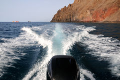 Sailing the blue sea on a boat outboard. Boat wake and outboard engine Royalty Free Stock Photography