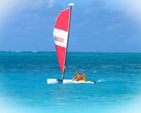 Sailing on a blue sea. A couple sails on the blue waters of the Turks and Caicos Islands Royalty Free Stock Image