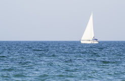 Sailing on blue sea Stock Images