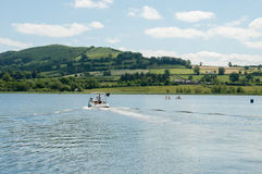 Sailing on the blue waters in the Brecon beacons of Wales. Royalty Free Stock Photo