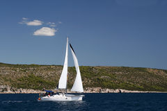 Sailing Boat. Small Yacht on blue water in Croatia Stock Photo