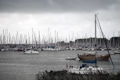 Sailing boat. Moored Saling boats in an harbor during bad weather Stock Photography