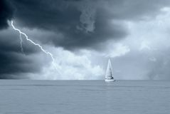 Sailing boat. Under stormy sky Stock Photos
