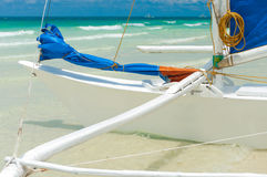 Sailing boat. Traditional paraw sailing boat on white beach on boracay island, Philippines Royalty Free Stock Photo