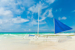 Sailing boat. Traditional paraw sailing boats on white beach on boracay island, Philippines Stock Photos