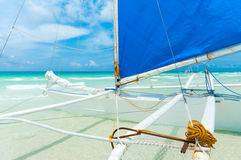 Sailing boat. Traditional paraw sailing boats on white beach on boracay island, Philippines Royalty Free Stock Photo