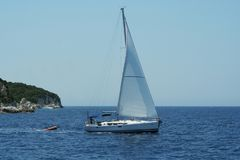 Sailing boat. Turist sailing in his boat near Anti Paxos Island Royalty Free Stock Photography