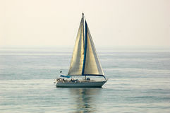 Sailing boat. On quiet sea Stock Images
