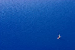 Sailing Boat. White sailing boat against a pure blue mediterranean sea, near Santorini Stock Photos