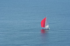 Sailing boat. With red sail Stock Images