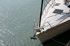 Sailing boat. Bow with glistening sunlit water Royalty Free Stock Photography