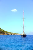 Sailing boat anchored in bay Royalty Free Stock Photo