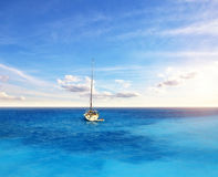 Sailing boat anchoring on open ocean, sailing and travel theme Royalty Free Stock Photography