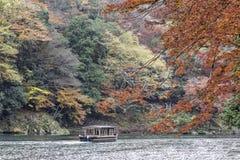 Sailing boat in autumn, Arashiyama, Kyoto, Japan.  Royalty Free Stock Photos