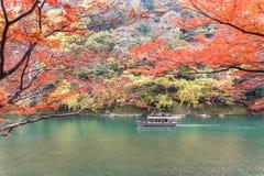 Sailing boat in autumn, Arashiyama, Kyoto, Japan.  Stock Photo