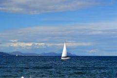 Sailing boat on azure coast. France Stock Images
