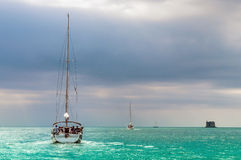 Sailing boat in a azure sea Royalty Free Stock Images