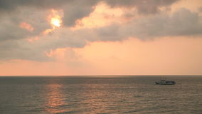 Sailing boat on a background of a beautiful sunset. stock video footage