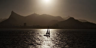 Sailing boat backlit in Rio de Janeiro Royalty Free Stock Image