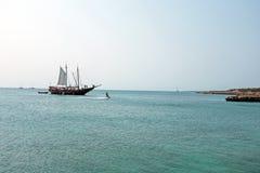 Sailing boat in a bay on Aruba island Royalty Free Stock Photo