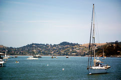 Sailing boat in the bay. Of a coastal village Stock Photos