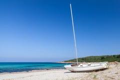 Sailing boat on beach, Corsica island, France Stock Photos