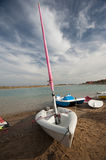 Sailing boat on a beach with stormy sky Royalty Free Stock Images