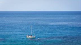 Sailing boat on blue mediterranean water in Ibiza island Royalty Free Stock Photo