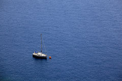 Sailing boat in blue sea, aerial view. Royalty Free Stock Image