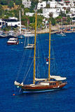 Sailing boat on blue water. Sailing boat in Bodrum Harbor, Turkey Stock Photo