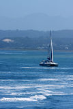 Sailing boat on blue water  Royalty Free Stock Photography