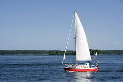 Sailing boat in blueand calm sea Royalty Free Stock Image