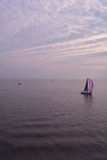 Sailing Boat in the calm sea, the Isle of Wight, England Stock Images