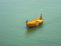 sailing boat on a calm water stock images