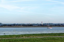 Banks of the Charente river. Sailing boat in the Charente river royalty free stock photo