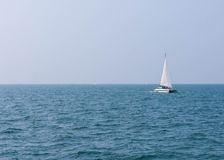 Sailing boat on the clear sea Stock Images