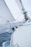 Sailing boat on cloudy windy day Stock Images