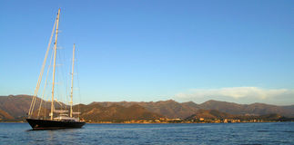 Sailing boat on corsica coast Royalty Free Stock Images
