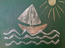 Sailing boat drawn on green chalk board Royalty Free Stock Photography