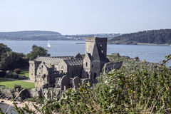 Sailing boat on Firth of Forth and Inchcolm Abbey Stock Photo