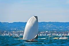 Sailing boat flying a spinnaker sail Stock Photography