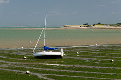 Sailing boat in the foreshore (Charente, France) Stock Photo
