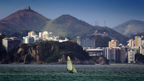 Sailing boat in front of Contemporary Art Museum in Niteroi Royalty Free Stock Image