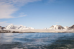 Sailing boat in front of the glacier in Svalbard, Arctic Royalty Free Stock Photo