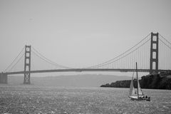 Sailing Boat in front of The Golden Gate Bridge. Black & White Photograph of a Yacht and The Golden Gate Bridge Royalty Free Stock Image